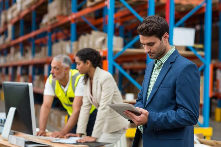 warehouse manager using tablet to check inventory